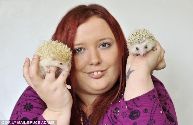 Emma Crossan, 24, with her pet pygmies Swarley, left, who is is three months old and Ella, right, who is six months old